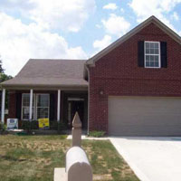 Brick House with Cement Driveway